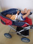 791: Red Pram Carrycot and Baby