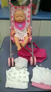 1050: Baby doll with stroller.