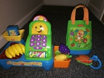AG17: fisher price till, scales, bag and prentend food
