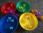 b3160: dinosaur and  coloured dishes