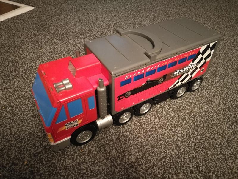 mi15: micro machine truck with 11 cars