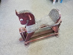 A0060: BROWN WOODEN ROCKING HORSE