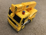 T210: Yellow crane truck with buttons