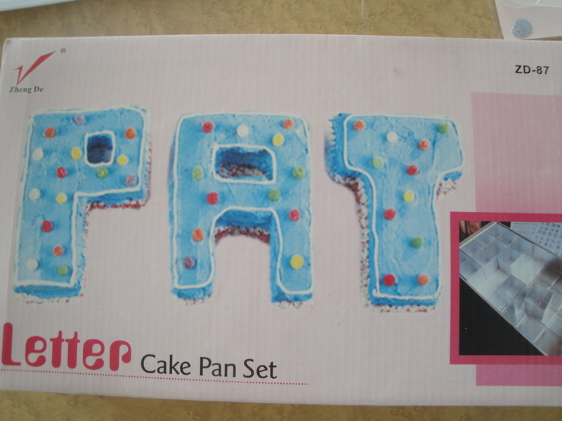 1229: Letters cake tin