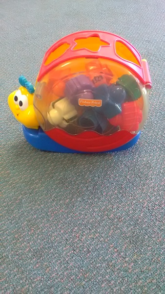 1328: singing snail shape sorter