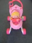 90: Pink musical push chair