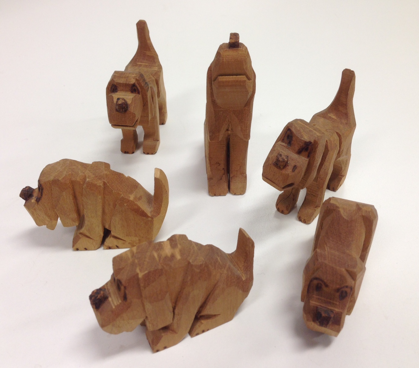 E654: Carved Wooden Dogs