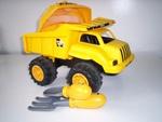 E057: CAT Tip Truck and helmet
