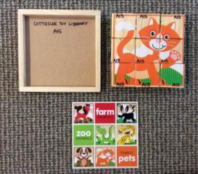 A15: Melissa and Doug Wooden Cube Puzzle