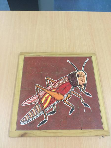 C2.189.1: ABORIGINAL ART GRASSHOPPER PUZZLE
