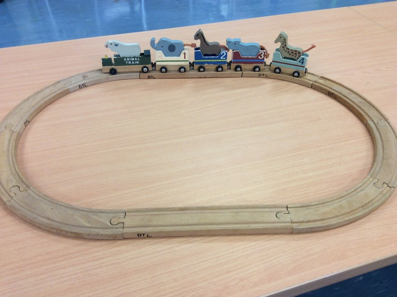 E2.883.1: WOODEN MAGNETIC ANIMAL TRAIN
