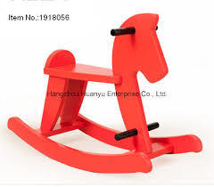 A2.407.1: RED WOODEN ROCKING HORSE