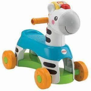 A270: Fisher Price Zebra ride on