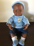 E64: Baby African male doll