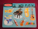 3212: MUSICAL INSTRUMENTS SOUND Peg Inset Puzzle