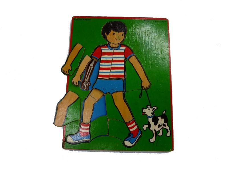 J863: Boy skeleton multiple layer inset puzzle