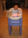 K047: HIGH CHAIR AND DOLL