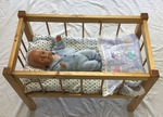 N1: Woden cot with Baby